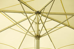 Umbrella detail. Close up of the inside of an open big umbrella Royalty Free Stock Photo