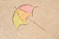 Umbrella drawing in sand Stock Photo