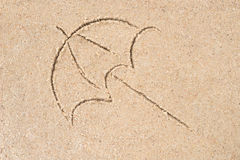 Umbrella drawing in sand Royalty Free Stock Photo