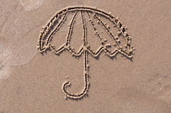 Umbrella drawn in the sand. Beach background. Royalty Free Stock Photos