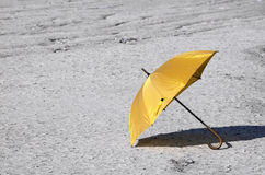Umbrella and dry land - RAW format Stock Images