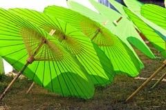 Umbrella Factory. Green color Umbrella displayed in a line,Umbrella making Factory BorSang,Sankhampaeng, Chiang Mai,Thailand Stock Photography