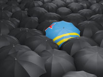 Umbrella with flag of aruba. Over black umbrellas Royalty Free Stock Images