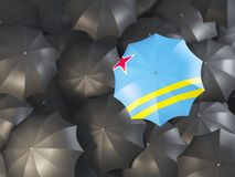 Umbrella with flag of aruba. On top of black umbrellas. 3D illustration Stock Image
