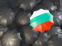 Umbrella with flag of bulgaria. On top of black umbrellas. 3D illustration Stock Photo
