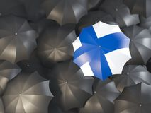 Umbrella with flag of finland. On top of black umbrellas. 3D illustration Royalty Free Stock Image