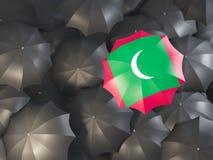 Umbrella with flag of maldives. On top of black umbrellas. 3D illustration Stock Image