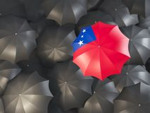 Umbrella with flag of samoa. On top of black umbrellas. 3D illustration Stock Photography