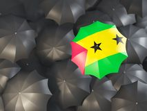 Umbrella with flag of sao tome and principe. On top of black umbrellas. 3D illustration Royalty Free Stock Photo