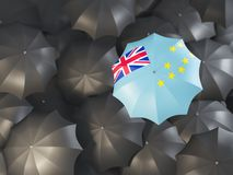 Umbrella with flag of tuvalu. On top of black umbrellas. 3D illustration Royalty Free Stock Photo