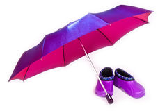 Umbrella and galoshes Stock Photography