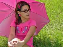 Umbrella girl. A girl with sunglasses and sun umbrella Stock Images