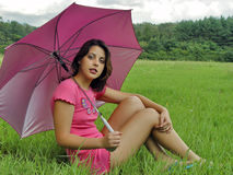 Umbrella girl. A girl with sun umbrella Royalty Free Stock Photo