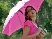 Umbrella girl. A girl with sunglasses and sun umbrella Royalty Free Stock Photography