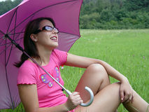 Umbrella girl. A girl with sunglasses and sun umbrella Royalty Free Stock Photos