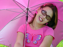 Umbrella girl. A girl with sunglasses and sun umbrella Royalty Free Stock Images
