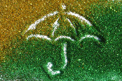 Umbrella of golden and green glitter sparkle on white background Royalty Free Stock Photo