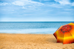 Umbrella on golden sand beach Royalty Free Stock Images