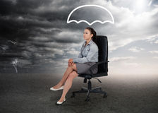 Umbrella graphic above the head of a businesswoman Stock Images