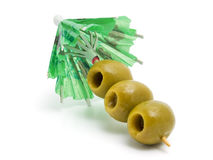 Umbrella and green olives Royalty Free Stock Photos