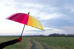 Umbrella in hand. Multi-colored umbrella Royalty Free Stock Photo