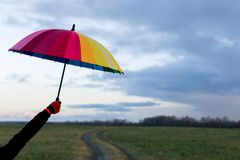 Umbrella in hand. Multi-colored umbrella Stock Photo