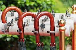 Umbrella handles. Red umbrella handles close-up stock photography