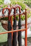 Umbrella handles. Red umbrella handles close-up stock photo