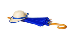 Umbrella and hat on white background royalty free stock photos