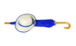 Umbrella and hat on white background royalty free stock photo