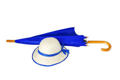 Umbrella and hat on white background royalty free stock image