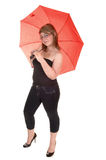 Umbrella holding teenager. Royalty Free Stock Images