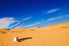 Umbrella on Issos beach, Corfu Stock Images