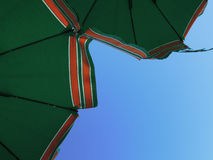 Umbrella in Italy. Umbrella on beach in italy with blue sky Royalty Free Stock Photography