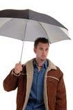 Umbrella and jacket stock image
