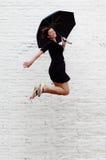 Umbrella Jump! Royalty Free Stock Photos