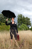 Umbrella lady. Portrait of a young woman with umbrella and bag Stock Photo