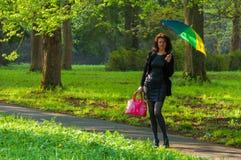 Umbrella and lady Stock Photos