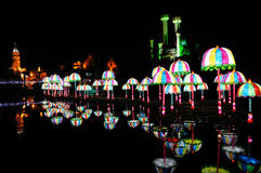 Umbrella lanterns on water Stock Photo