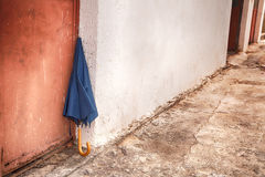 Umbrella leaning on the old city wall Royalty Free Stock Photo