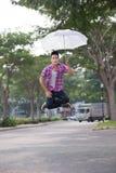Umbrella levitation Stock Photo