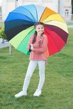 Umbrella for little happy girl. Rainbow after rain. cheerful child. Spring style. Positive mood in autumn rainy weather. Little girl protected with colorful stock photos