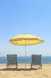 Umbrella and lounge chairs on idyllic beach. In Thassos island - Greece Royalty Free Stock Photo