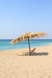 Umbrella and lounge chairs on idyllic beach. In Thassos island - Greece Royalty Free Stock Photos