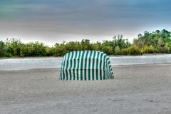 Umbrella lounges on Marco Island, Florida. Beach under an overcast sky in winter stock photography