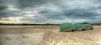 Umbrella lounges on Marco Island, Florida. Beach under an overcast sky in winter stock image