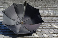 Umbrella and moderny roof. Umbrella on the wood's roof Royalty Free Stock Photo