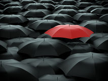 Umbrella over many black umbrellas. Red umbrella over many black umbrellas Royalty Free Stock Photography