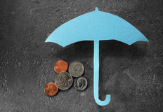 Umbrella over money Royalty Free Stock Image