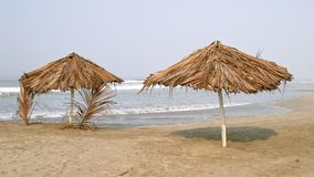 Umbrella and palapa on the beach Royalty Free Stock Image